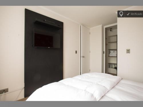 Cama o camas de una habitación en Altos Alameda O'Higgins