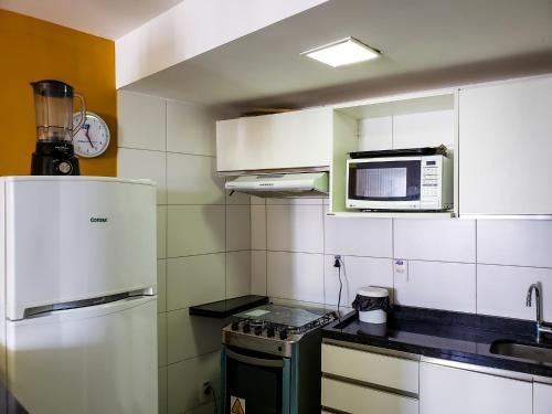 A kitchen or kitchenette at Lindo Flat em Boa Viagem