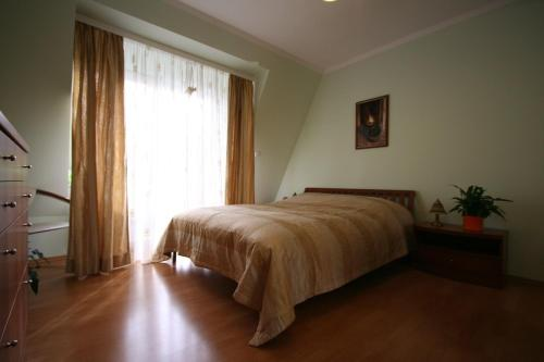 Postel nebo postele na pokoji v ubytování Marianka