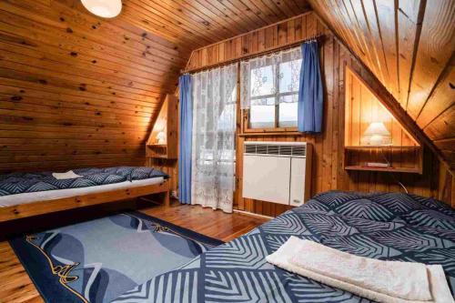 Postel nebo postele na pokoji v ubytování Apartments Penzion Štôla