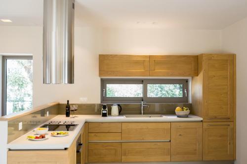 A kitchen or kitchenette at Almyra Villas