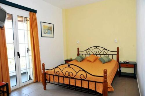 A bed or beds in a room at Papoulias Rooms