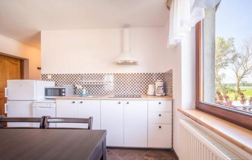 A kitchen or kitchenette at Apartamenty Prima