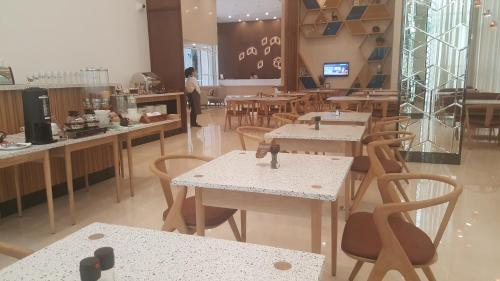 A restaurant or other place to eat at Citadines Regency Saigon