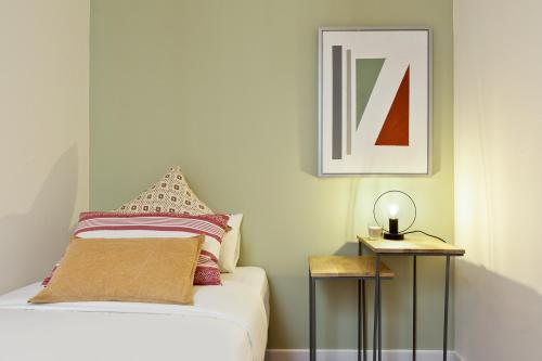 A bed or beds in a room at Olala Diagonal Apartment