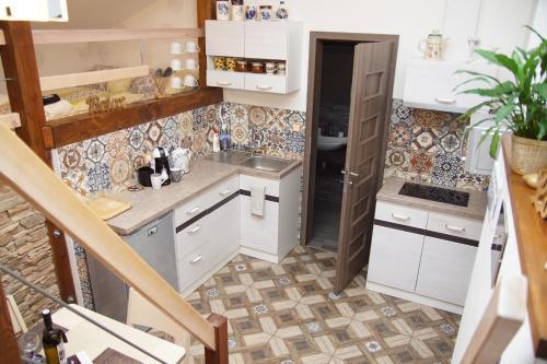 Kuchyň nebo kuchyňský kout v ubytování Luxusní Apartmán NMNM