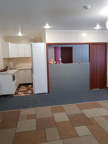 Кухня или мини-кухня в Гостевой дом Tourist