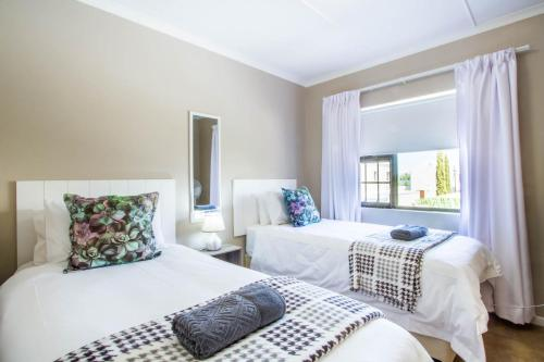 A bed or beds in a room at El Dorado Hotel and Self Catering