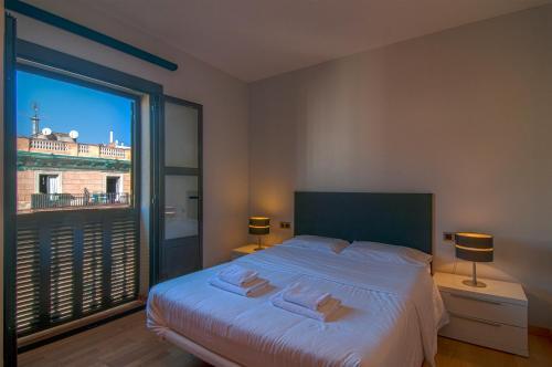 Ein Bett oder Betten in einem Zimmer der Unterkunft Tamarit Apartments