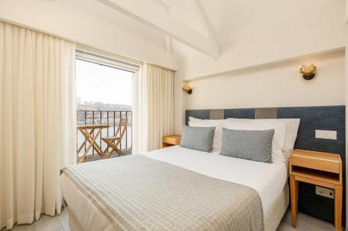 Un ou plusieurs lits dans un hébergement de l'établissement Your Opo Ribeira Apartments Porto