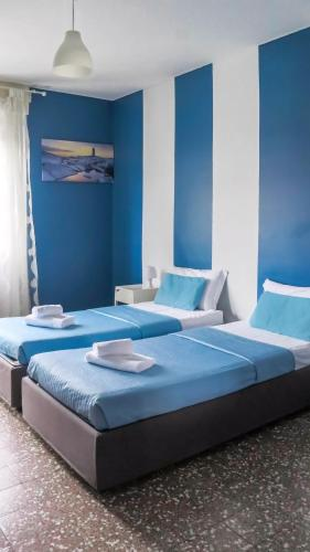 A bed or beds in a room at I Am Here - Gioia 71