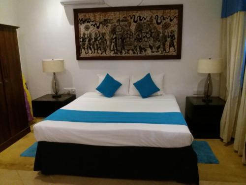 Łóżko lub łóżka w pokoju w obiekcie Sujeewani Villa