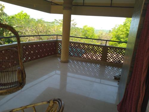 A balcony or terrace at Shastri cottege