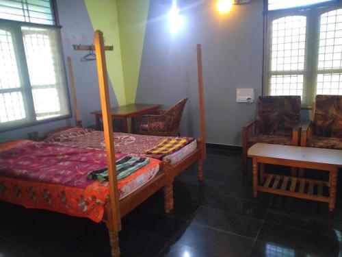 A bed or beds in a room at Shastri cottege