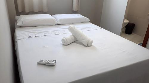 A bed or beds in a room at Hart Aparthotel Ltda
