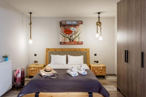 A bed or beds in a room at Supreme Comfort Apartments by Athens Stay