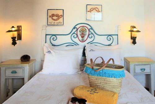 Ein Bett oder Betten in einem Zimmer der Unterkunft Villa Ana Margarida Beach