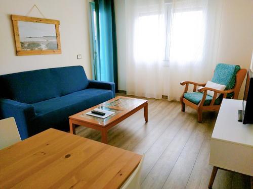 Кът за сядане в Apartamentos Rodeiramar 2A