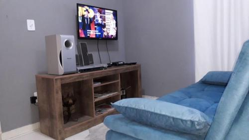 A television and/or entertainment centre at Ap Aldeia dos Anjos