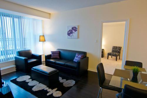 Et opholdsområde på Maplewood Furnished Suites