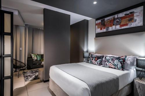 A bed or beds in a room at CAG The Vantage Rosebank