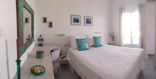 Ένα ή περισσότερα κρεβάτια σε δωμάτιο στο Captain's