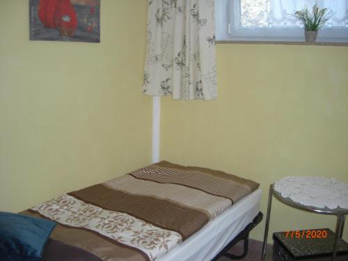 Ein Bett oder Betten in einem Zimmer der Unterkunft Appartement Am Goldberg