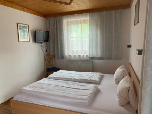 A bed or beds in a room at Appartement Hammerschmidt
