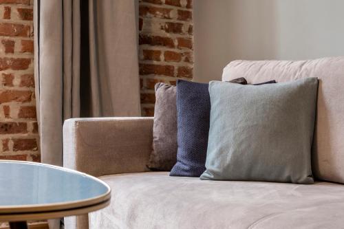 Posteľ alebo postele v izbe v ubytovaní Relaks Apartamenty
