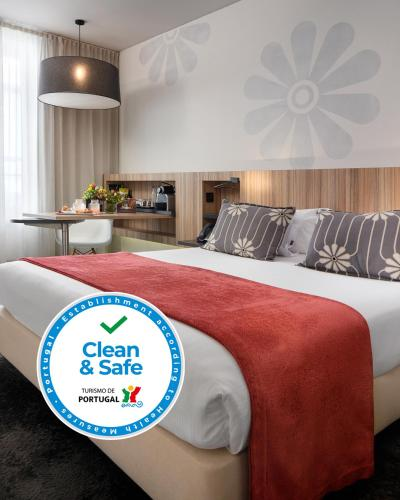 A bed or beds in a room at Inspira Santa Marta Hotel & Spa