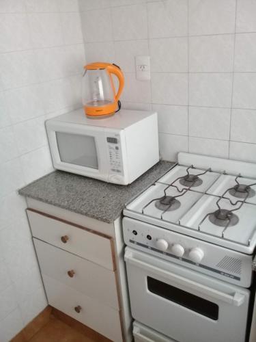A kitchen or kitchenette at Apart Hotel Marilian