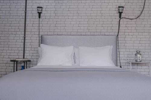 A bed or beds in a room at Casa do Lume