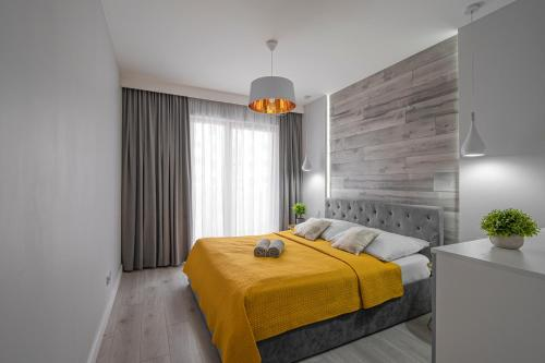 A bed or beds in a room at Dream4You Apartments