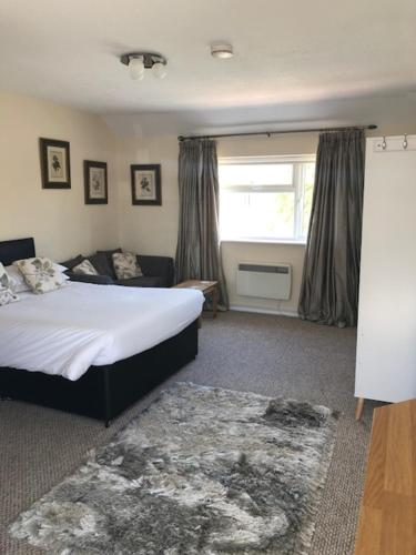 A bed or beds in a room at Brookacre Self Catering
