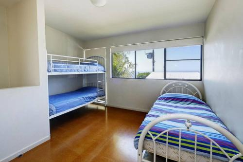 A bunk bed or bunk beds in a room at Headland Home