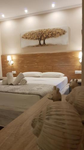 A bed or beds in a room at Agrili