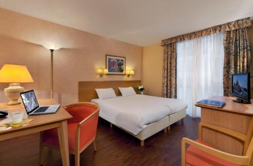 Кровать или кровати в номере Citadines Kurfürstendamm Berlin Aparthotel