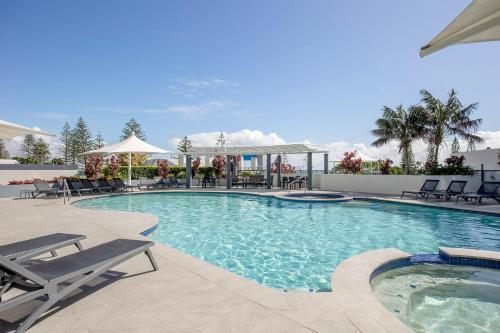 The swimming pool at or near Mantra Mooloolaba Beach