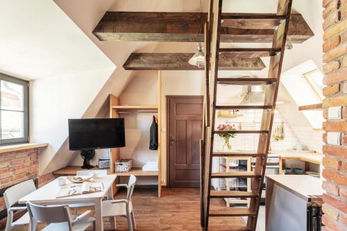 Telewizja i/lub zestaw kina domowego w obiekcie Apartament Gdański Gród