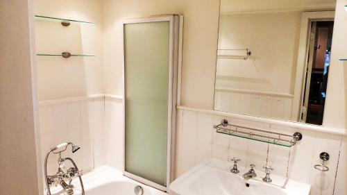 Een badkamer bij vakantiewoning Charme Aan Zee