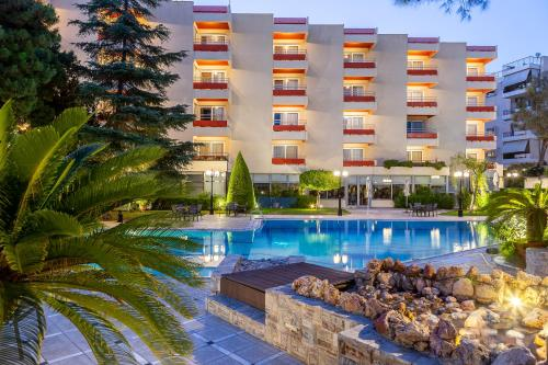 The swimming pool at or near Oasis Hotel Apartments