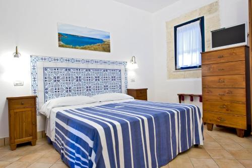 A bed or beds in a room at Miramare Residence