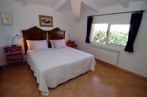 Ein Bett oder Betten in einem Zimmer der Unterkunft Acero Appartamenti