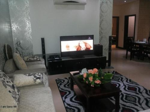 A television and/or entertainment center at Khayal Hotel Apartments