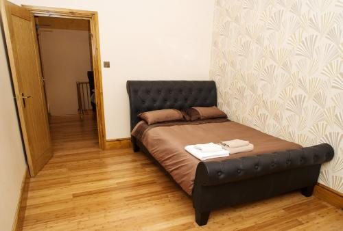 A bed or beds in a room at London Finsbury Park Apartments