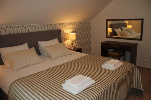 A bed or beds in a room at Marina Holiday Honka Village