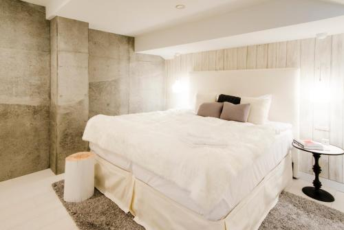 A bed or beds in a room at Loft Niseko