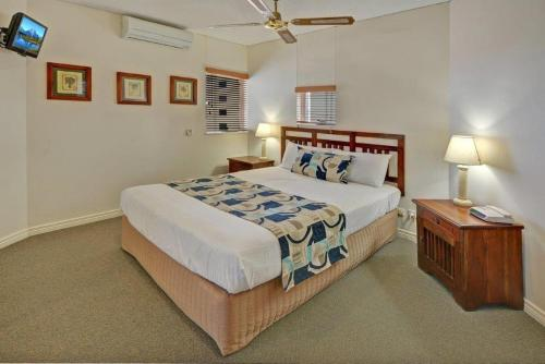 A bed or beds in a room at Raffles Mooloolaba