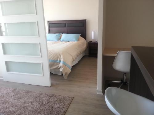 Cama o camas de una habitación en Santa Rosa Suites