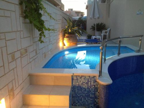 The swimming pool at or near Angelica Studios and Apartments